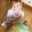 Child with a globe - Stock Photo