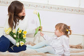 Mother and child having fun at home — Stock Photo