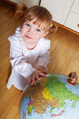 Child with a globe — Stock Photo