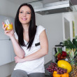 Beautiful woman drinking fresh orange juice — Stock Photo