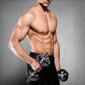 Exercise with dumbbells — Stock Photo
