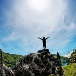 Man on peak of mountain. Conceptual design. — Stock Photo