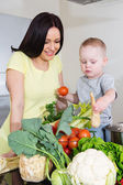 Mother and child at kitchen — Stock Photo