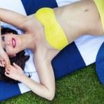 Sexy woman laying on grass — Stock Photo