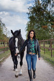 Beautiful woman with horse — Stock Photo