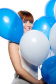 Woman holding balloons — Stock Photo