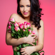 Sexy woman with flowers — Stock Photo