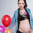 Pregnant womwith colorful balloons — Stock Photo #40108287