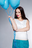 Pregnant woman with blue balloons — Stock Photo