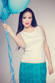 Pregnant woman with colorful balloons — Stock Photo