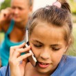 Stock Photo: Girls with mobile telephone
