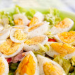 Eggs in salad — Stock Photo