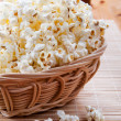 Pop corn in wickerwork — Stock Photo