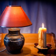 Wax candle and electric lamp — Stock Photo