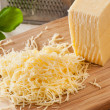 Grated yellow cheese — Stock Photo