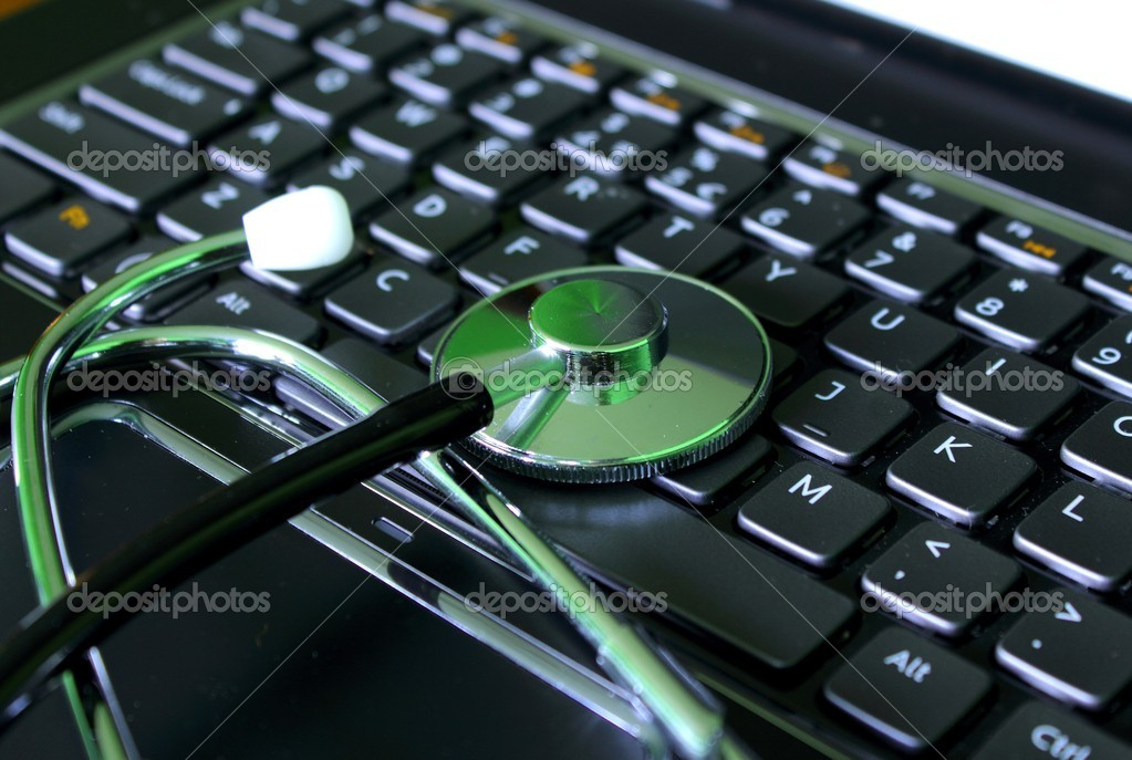 Medical stathoscope on laptop computer — Stock Photo #12059652