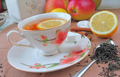 Tea cup with lemon — Stock Photo