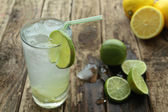 Cold drink with fresh lime and ice — Stock Photo