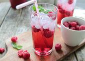 Juice from fresh rasberries with ice — Stock Photo
