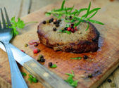 Grilled beef steak with fresh rosemary herbs — Stock Photo