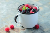 Mug with fruits — Stock Photo