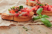 Fresh bruschettas for appetizer with vegetables — Stock Photo
