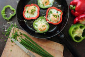 Eggs fried in peppers — Stock Photo