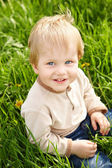 Happy little boy in grass — Stock Photo