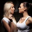 Beautiful woman exhaling smoke into face brunette - Stock Photo
