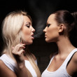 Beautiful woman exhaling smoke into face brunette - Foto de Stock