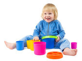 Cute baby boy plays with buckets — Stock Photo