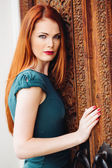 Outdoor portrait of beautiful redhead young woman — Foto Stock