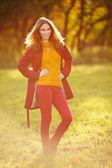 Outdoor portrait of beautiful redhead woman — Stock Photo
