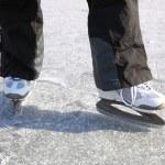 Ice skating outdoors pond freezing winter — Stock Photo
