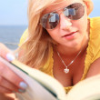 Stock Photo: Womreading book girl yellow dress