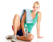 Beautiful girl drinking water blue bottle isolated — Stock Photo
