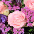 Pink and purple flower arrangement — Stock Photo #12009391