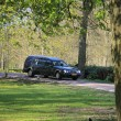 Black hearse on cemetary - Stock Photo