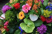 Mixed floral arrangement in bright colors — Stock Photo
