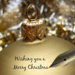 Pen writing golden ornament greeting card — Stock Photo #14339605