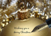 Pen writing golden ornament greeting card — Stock Photo