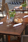 Wooden tables at a restaurant — Stock Photo