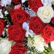 Stock Photo: White and red roses in a bouquet
