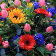 Mixed floral arrangement in bright colors — Stock Photo #16314959