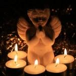Christmas angel and votive lights — Stock Photo #1698447