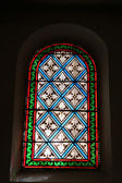 Stained glass in a church in Nyons — Stockfoto