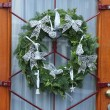 Christmas wreath on a glass door — Photo