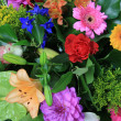 Mixed floral arrangement in bright colors - Stockfoto