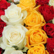 Yellow, white and red roses in a wedding arrangement — ストック写真