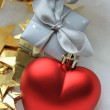Christmas gift and decorations, red heart — Stock Photo